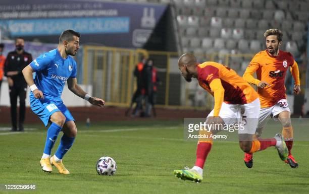 Emrah Bassan of Buyuksehir Belediye Erzurumspor in action against Marcao of Galatasaray during Turkish Super Lig match between Buyuksehir Belediye...