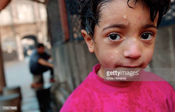Emre a threeyearold Kurdish boy stands with water on his face after washing in the courtyard of Ulu Camii January 8 2003 in Diyarbakir the capital of...