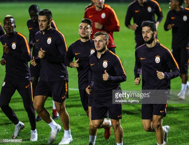 Emre Akbaba along with other players of Galatasaray attend a training session ahead of UEFA Champions League Group D match against Lokomotiv Moscow...