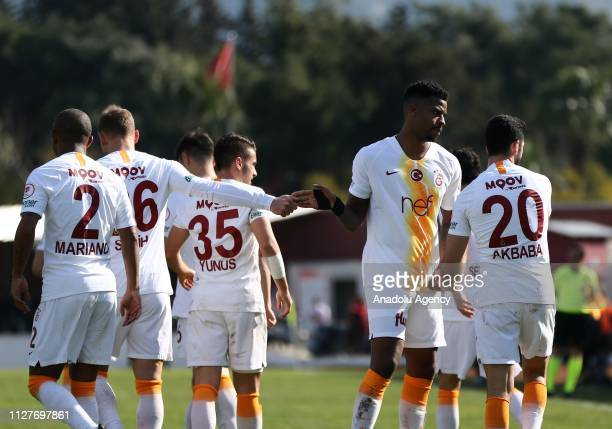 Emre Akbaba of Galatasaray celebrates with his team mates after scoring a goal during the Ziraat Turkish Cup quarter final return match between...