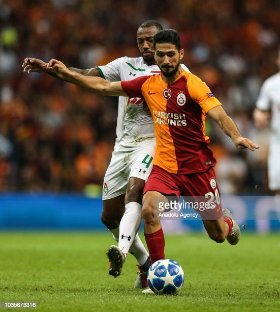 Emre Akbaba of Galatasaray in action against Manuel Fernandes of Lokomotiv Moscow during UEFA Champions League Group D match between Galatasaray and...