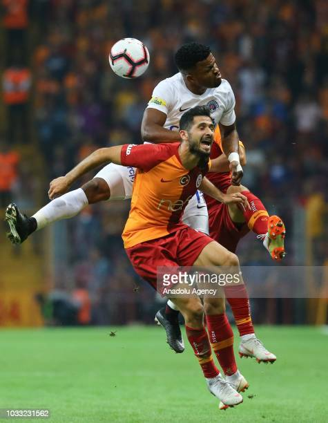Emre Akbaba of Galatasaray in action against Samuel Eduok of Kasimpasa during Turkish Super Lig soccer match between Galatasaray and Kasimpasa at...