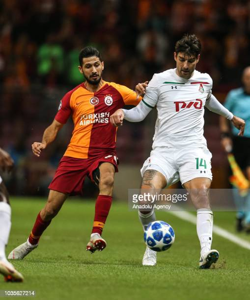 Emre Akbaba of Galatasaray in action against Vedran Corluka of Lokomotiv Moscow during UEFA Champions League Group D match between Galatasaray and...