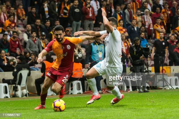 Emre Akbaba of Galatasaray SK Charles Fernando Basílio da Silva of Antalyaspor AS during the Turkish Spor Toto Super Lig football match between...