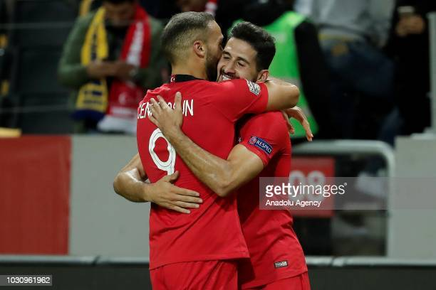 Emre Akbaba of Turkey celebrates with his team mate Cenk Tosun of Turkey after scoring a goal during the UEFA Nations League Group 2 of League B...