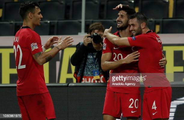 Emre Akbaba of Turkey celebrates with his team mates Kaan Ayhan and Omer Bayram of Turkey after scoring a goal during the UEFA Nations League Group 2...