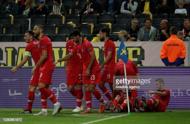 Emre Akbaba of Turkey celebrates with his teammates after scoring a goal during the UEFA Nations League Group 2 of League B soccer match between...