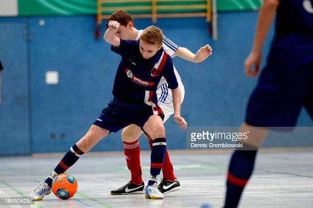 Emre Akbulut of Holstein Kiel and Andre Beier of Hollenbach battle for the ball during the DFB C Juniors Futsal Cup final between KSV Holstein Kiel...