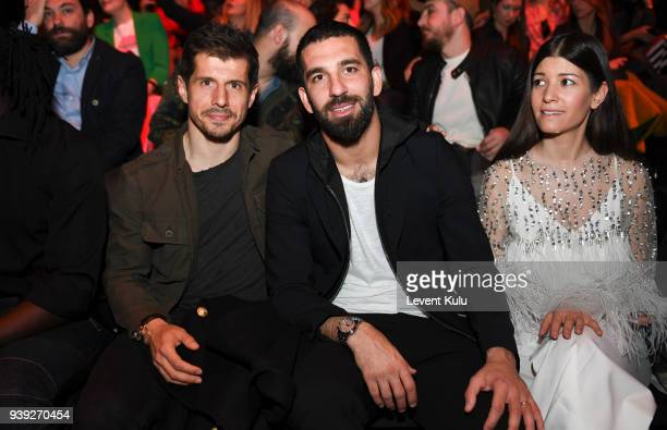 Emre Belezoglu and Arda Turan attend the St Nian show during Mercedes Benz Fashion Week Istanbul at Zorlu Performance Hall on March 28 2018 in...