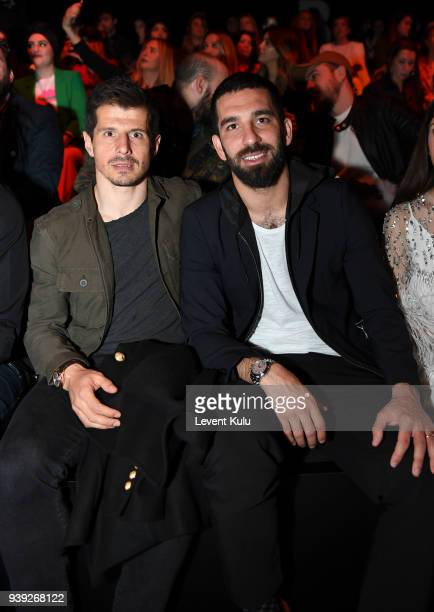 Emre Belezoglu and Arda Turan attends the St Nian show during Mercedes Benz Fashion Week Istanbul at Zorlu Performance Hall on March 28 2018 in...