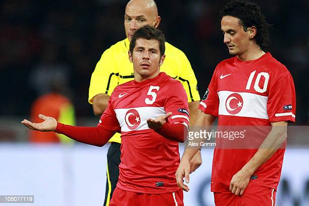 Emre Beloezoglu and Tuncay Sanli of Turkey react during the EURO 2012 group A qualifier match between Germany and Turkey at the Olympic Stadium on...