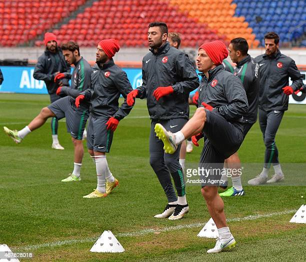 Emre Belozoglu and Burak Yilmaz of Turkish National Football team attend a training session at Amsterdam Arena in Amsterdam Holland on March 27 2015...