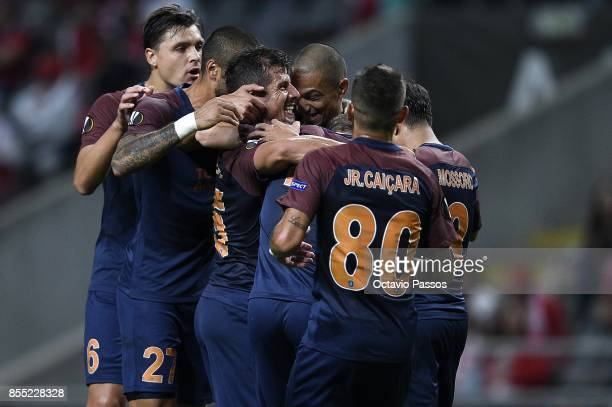Emre Belozoglu of Basaksehir FK celebrates with teammates after scoring the first goal during the UEFA Europa League group C match between Sporting...
