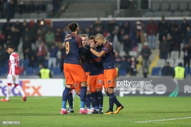 Emre Belozoglu of Medipol Basaksehir celebrates with his teammates after scoring a goal during UEFA Europa League Group C soccer match between...