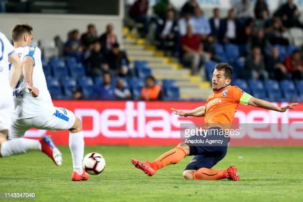 Emre Belozoglu of Medipol Basaksehir in action against Ante Kulisic of MKE Ankaragucu during a Turkish Super Lig football match between Medipol...