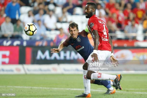 Emre Belozoglu of Medipol Basaksehir in action against Johannes of Antalyaspor during the Turkish Super Lig match between Antalyaspor and Medipol...