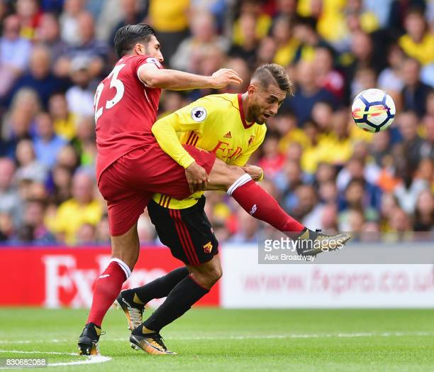 Emre CAan of Liverpool and Roberto Pereyra of Watford battle for possession during the Premier League match between Watford and Liverpool at Vicarage...