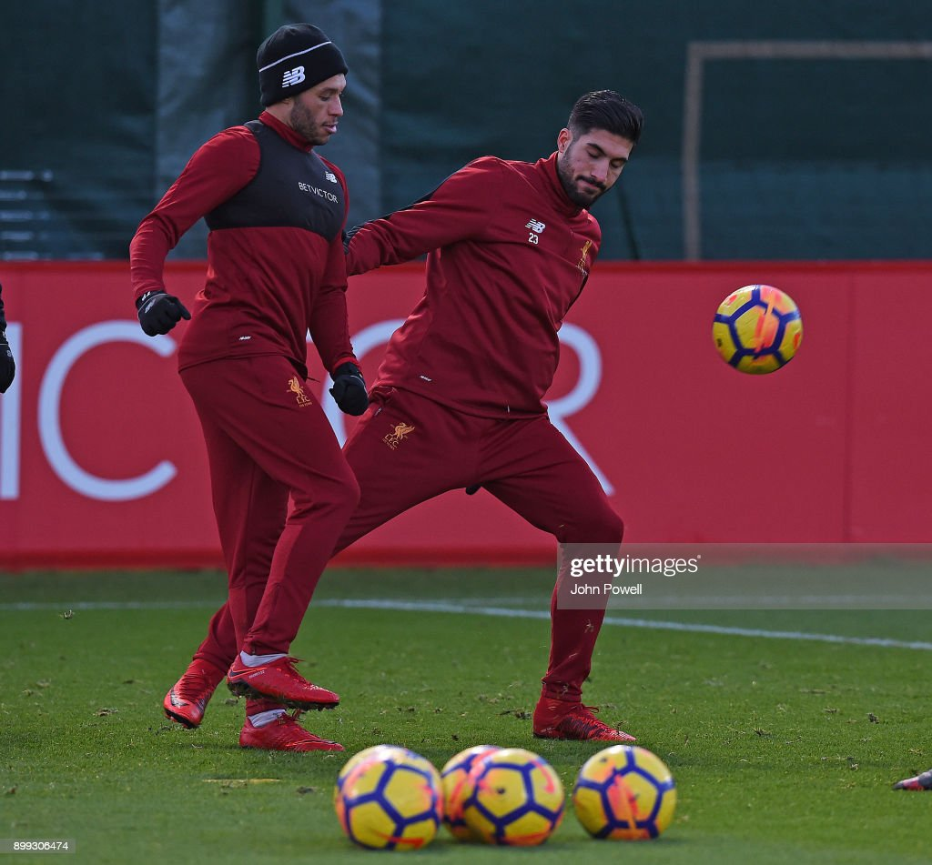 Emre Can and Alex Oxlade-Chamberlain of Liverpool during a training session at Melwood Training Ground on December 28, 2017 in Liverpool, England.