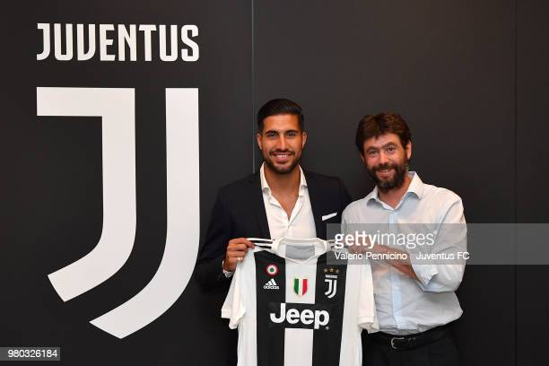 Emre Can poses as he signs a contract with Juventus at Juventus headquarters on June 21 2018 in Turin Italy