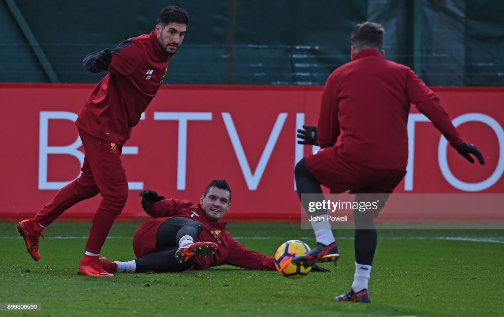 Emre Can and Dejan Lovren of Liverpool during a training session at Melwood Training Ground on December 28, 2017 in Liverpool, England.
