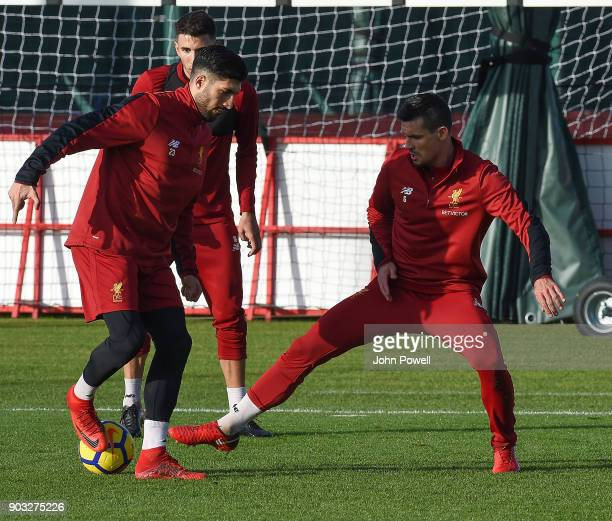 Emre Can and Dejan Lovren of Liverpool during a training session at Melwood Training Ground on January 10 2018 in Liverpool England