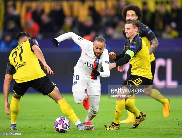 Emre Can and Lukasz Piszczek of Dortmund challenges Neymar of Paris SG during the UEFA Champions League round of 16 first leg match between Borussia...