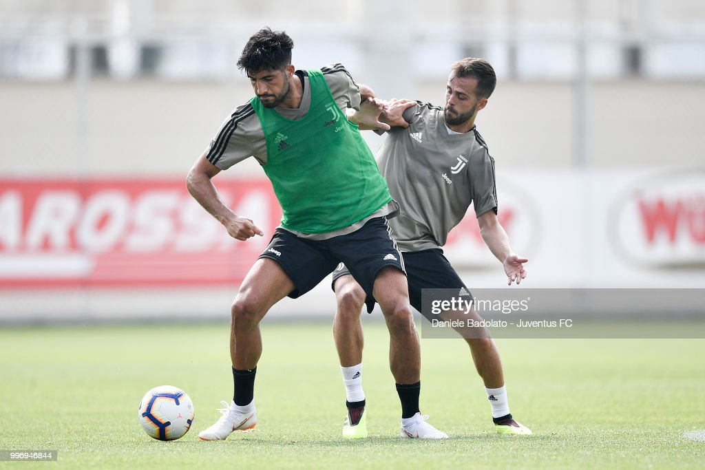 Emre Can and Miralem Pjanic during a Juventus training session at Juventus Training Center on July 12, 2018 in Turin, Italy.