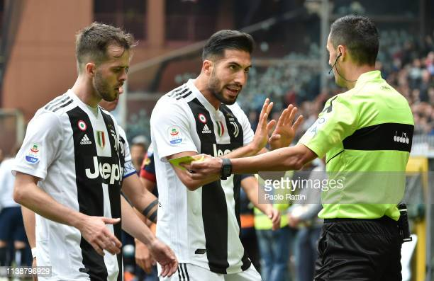 Emre Can and Miralem Pjanic of Juventus argue with referee Marco Di Bello during the Serie A match between Genoa CFC and Juventus at Stadio Luigi...