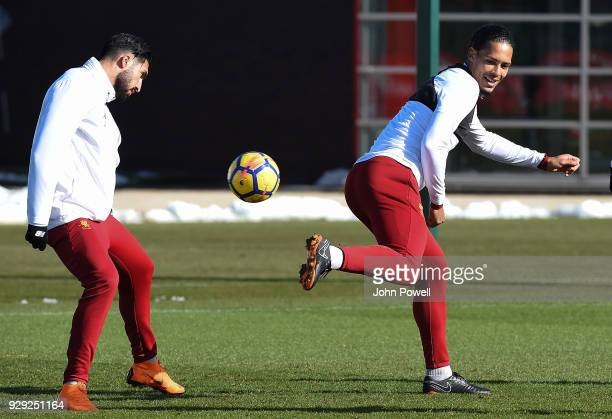 Emre Can and Virgil van Dijk of Liverpool during a training session at Melwood Training Ground on March 8 2018 in Liverpool England