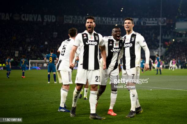 Emre Can Blaise Matuidi and Cristiano Ronaldo of Juventus FC celebrate the victory at the end of the UEFA Champions League Round of 16 second leg...