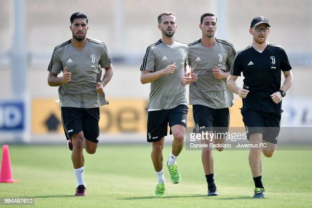 Emre Can Miralem Pjanic Mattia De Sciglio and Enrico Maffei during a Juventus training session at Juventus Training Center on July 9 2018 in Turin...