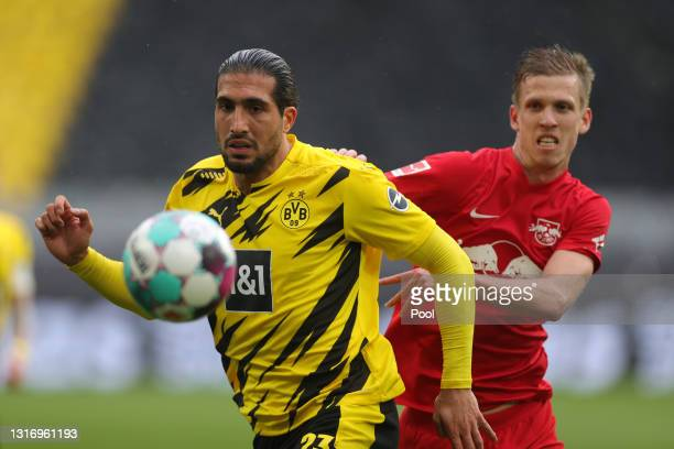 Emre Can of Borussia Dortmund and Dani Olmo of RB Leipzig battle for the ball during the Bundesliga match between Borussia Dortmund and RB Leipzig at...
