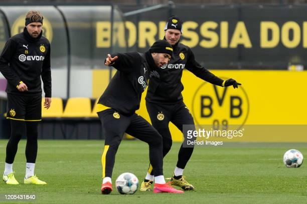 Emre Can of Borussia Dortmund and Lukasz Piszczek of Borussia Dortmund battle for the ball during the Borussia Dortmund Training Session on March 05...