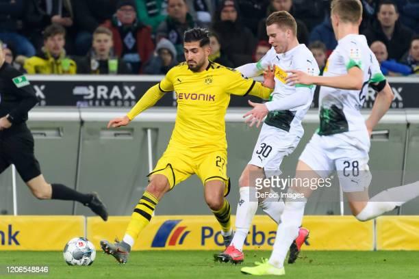 Emre Can of Borussia Dortmund and Nico Elvedi of Borussia Moenchengladbach battle for the ball during the Bundesliga match between Borussia...