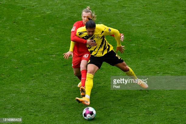 Emre Can of Borussia Dortmund battles for possession with Emil Forsberg of RB Leipzig during the Bundesliga match between Borussia Dortmund and RB...