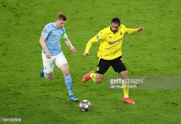 Emre Can of Borussia Dortmund battles for possession with Kevin De Bruyne of Manchester City during the UEFA Champions League Quarter Final match...