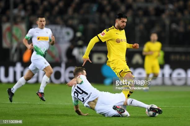Emre Can of Borussia Dortmund battles for possession with Tony Jantschke of Borussia Moenchengladbach during the Bundesliga match between Borussia...