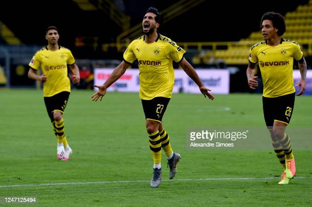 Emre Can of Borussia Dortmund celebrates after scoring his team's first goal with his teammates Axel Witsel and Achraf Hakimi of Borussia Dortmund...