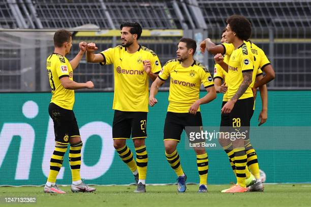Emre Can of Borussia Dortmund celebrates scoring his teams first goal of the game with team mates during the Bundesliga match between Borussia...