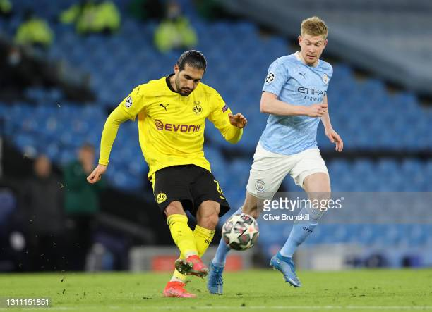 Emre Can of Borussia Dortmund passes the ball under pressure from Kevin De Bruyne of Manchester City during the UEFA Champions League Quarter Final...