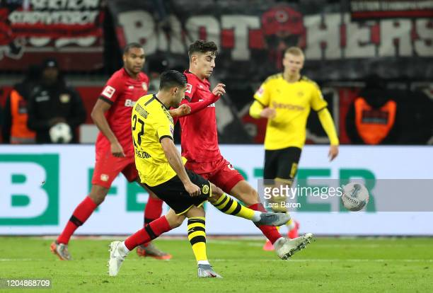 Emre Can of Borussia Dortmund scores his team's second goal during the Bundesliga match between Bayer 04 Leverkusen and Borussia Dortmund at BayArena...