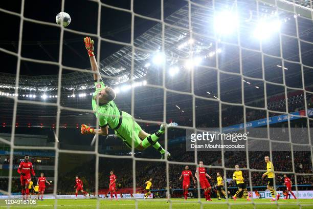 Emre Can of Borussia Dortmund scores his teams second goal past Goalkeeper Lukas Hradecky of Bayer 04 Leverkusen during the Bundesliga match between...