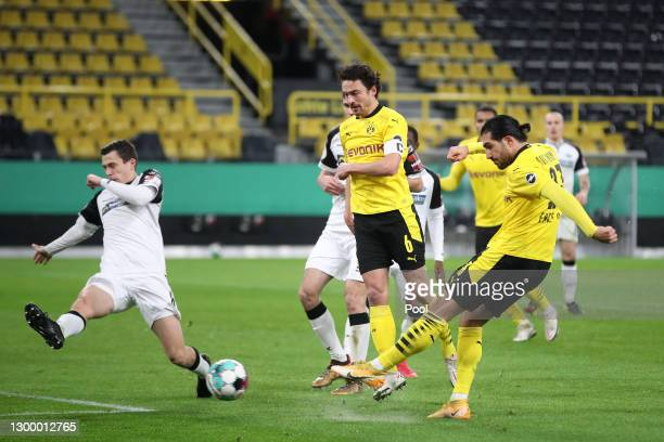 Emre Can of Borussia Dortmund scores their side's first goal during the DFB Cup Round of Sixteen match between Borussia Dortmund and SC Paderborn 07...