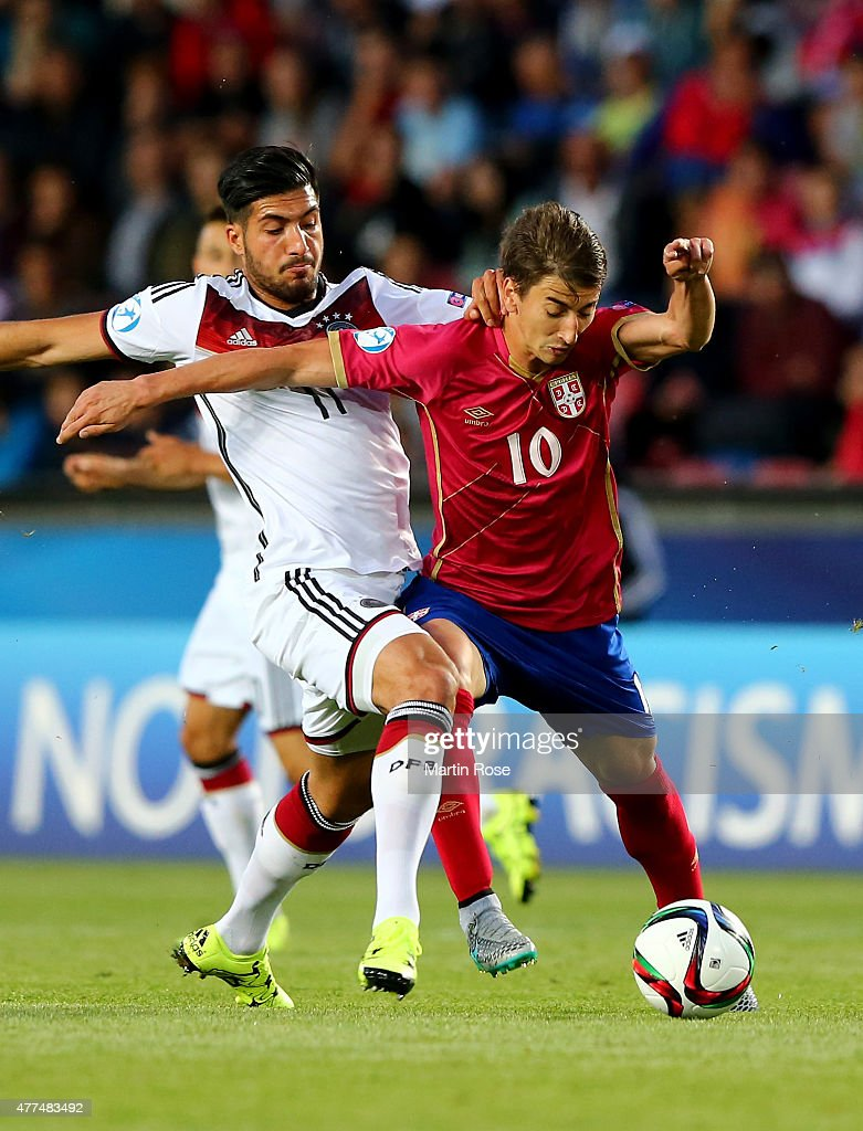 Emre Can (L) of Germany and Filip Djuricic of Serbia battle for the ball during the UEFA European Under-21 Group A match between Germany and Serbia at Letna Stadium on June 17, 2015 in Prague, Czech Republic.