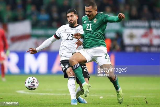 Emre Can of Germany and Josh Magennis of Northern Ireland battle for possession during the UEFA Euro 2020 Qualifier between Germany and Northern...