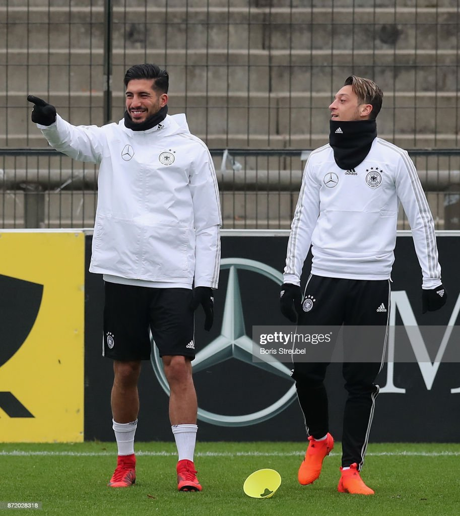 Emre Can of Germany and Mesut Oezil of Germany react during a training session of the German National team at Stadion auf dem Wurfplatz on November 9, 2017 in Berlin, Germany.