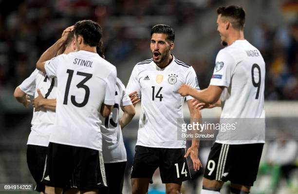 Emre Can of Germany celebrates with team mates during the FIFA 2018 World Cup Qualifier between Germany and San Marino at Stadion Nuernberg on June...