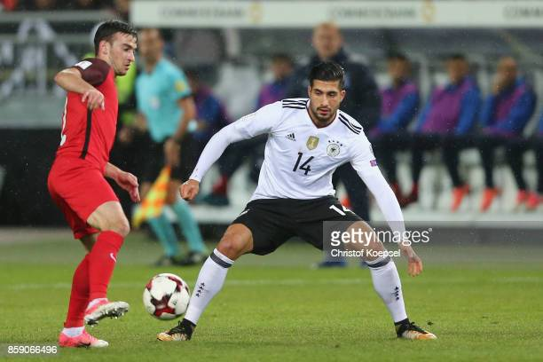 Emre Can of Germany challenges Gara Garayev of Azerbaijan during the FIFA 2018 World Cup Qualifier between Germany and Azerbaijan at...