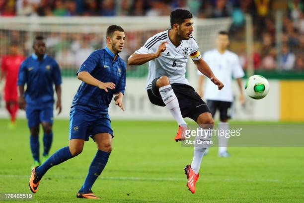 Emre Can of Germany is challenged by Valentin Eysseric of France during the U21 match between Germany and France on August 13 2013 in Freiburg im...