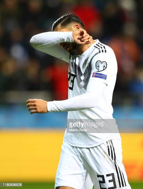 Emre Can of Germany leaves the field after being sent off during the UEFA Euro 2020 qualifier between Estonia and Germany on October 13, 2019 in...